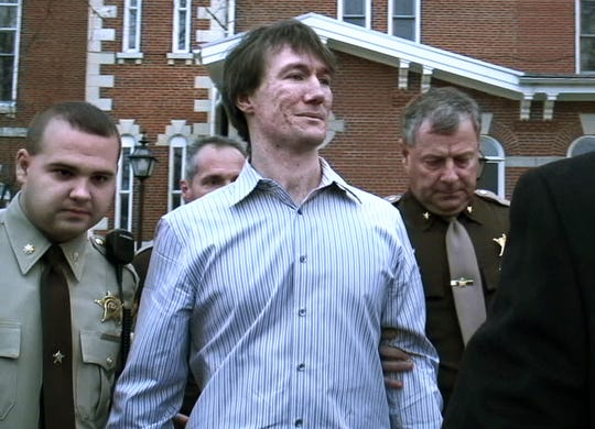 John R. Myers II , center, is led from the Morgan County Courthouse on Dec. 1, 2006, after being sentenced to 65 years in prison for the 2000 murder of Jill Behrman.