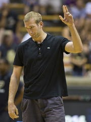 Robbie Hummel was a star at Purdue, but injuries limited him to two years in the NBA. He acknowledged the crowd before an  alumni basketball game  Aug. 2, 2014, at Mackey Arena in West Lafayette.