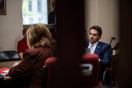Jackson Mayor Scott Conger, right, reads during a Jackson City Council agenda review meeting in Jackson, Tenn.