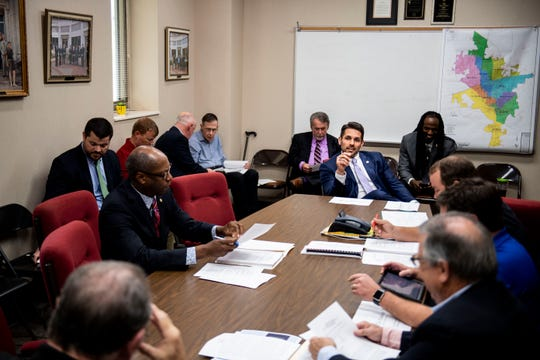 The Jackson City Council meets for agenda review before a meeting.