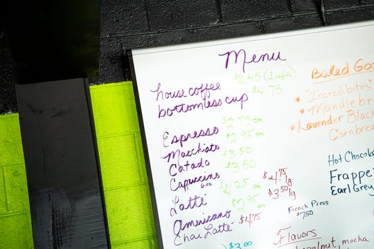 A menu hangs on the wall behind the counter at Perk City coffee shop at 3229 E. Magnolia Ave. in Knoxville on Oct. 1, 2019.