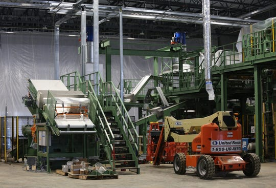 A calender machine is put together at the new Nokian Tyres plant in Dayton, Tennessee, in February. The machine weaves fabric into rubber for use in production of tires.