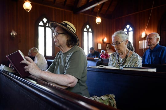 """I used to be a Baptist,"" said Linda Konig, left, ""but this church is so welcome to anybody."" Christ Church Episcopal, built in 1887, serves as the spiritual heart of tiny Rugby, Tenn."