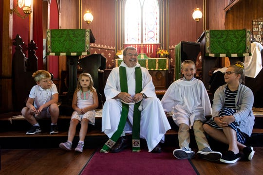 """""""This is my favorite part of service,"""" the Rev. Joe Minarik said about sitting and chatting with children during Sunday service at Christ Church Episcopal."""