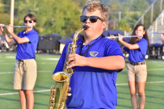 The Karns High marching band performs at the 2019 Knox County Schools band exhibition with their halftime show, Monday, Sept. 30, 2019.