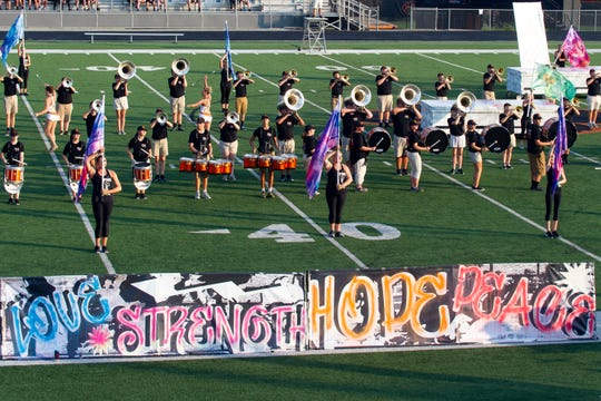 Powell High School Marching Panther Band performing at the Knox County Band Exhibition at Powell High School on Monday, September 30, 2019.