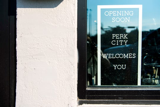 An 'Opening Soon' sign hangs in the wall at the Perk City coffee shop located at 3229 E. Magnolia Ave. in Knoxville on Tuesday, Oct. 1, 2019.