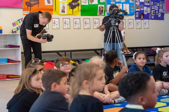 A film crew from the New Orleans Saints organization films Caryn Bodin, music teacher at Martial F. Billeaud Elementary in Broussard, Tuesday to shoot footage of her class. It will be used in a video featuring Bodin as Chevron Teacher of the Week at the Nov. 24 home Saints game against the Carolina Panthers. Production manager Brianna Latino and shooter-editor Jonathan Mahody recorded Bodin leading second-grade students in songs, sight reading activities and echo rhythms with instruments. Tuesday, Oct. 1, 2019.