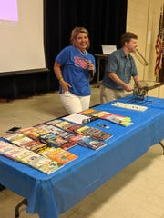 Broadmoor Elementary teachers Dana Rivera and Frankie Mulligan call out numbers during Book Bingo, where the prizes are new books from Scholastic. The event is a regular fixture at the school aimed at increasing parental involvement. The next Book Bingo night is Oct. 10 forthird- and fourth-graders and their families.