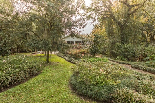 Almost 5,000 square foot mansion on 1.9 acres in the heart of Lafayette comes with three distinct living areas, a pool, and hardwood floors throughout.