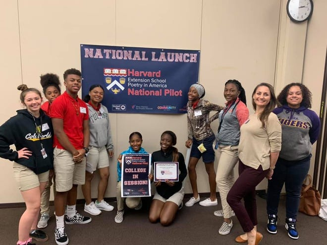 """Nine seniors at Northside High are taking a dual enrollment course through Harvard Extension School. The class is called """"Poetry in America: The City from Whitman to Hip Hop."""""""