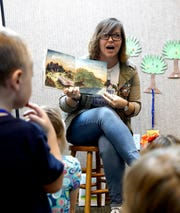 "Erin Barker reads her new book ""Mr. Pumpkins Tea Party"" Tuesday morning, Oct. 1, 2019, to a group of children at Wagnall's Memorial Library in Lithopolis. The book is the second children's book Barker, a Lancaster native, has written."