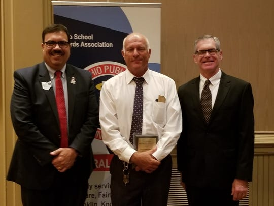 """Robert Slater II (Center) was honored at the Central Region Fall Conference of Ohio School Board Association as """"Friend of Public Education""""."""