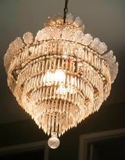 The chandelier that hangs in the Arnold home's entrance foyer once hung in Louisville's Rialto movie theater and was bought after the theater closed in 1968.