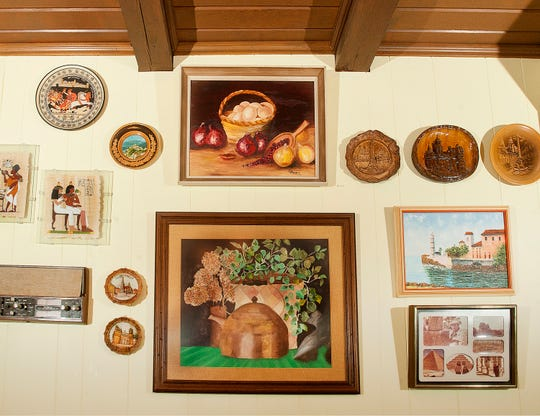 Some of the artwork collected by the Arnolds hangs on a kitchen wall.