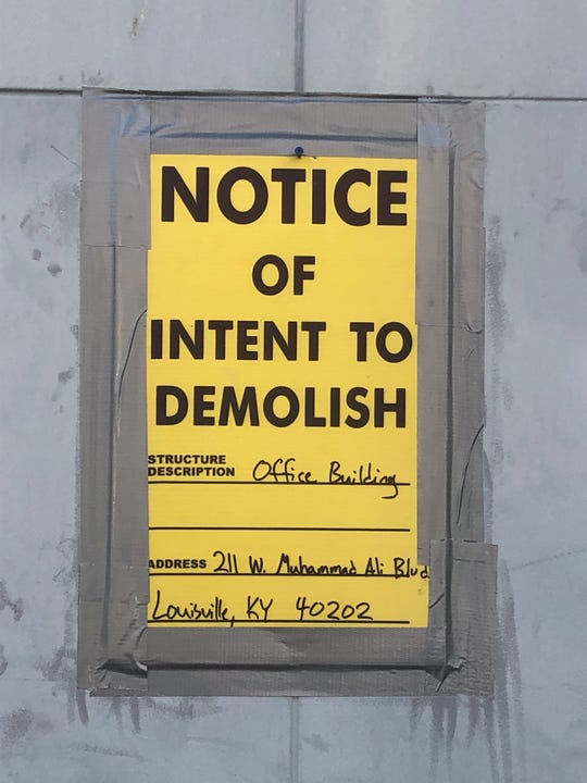 A notice of intent to demolish sign on the Odd Fellows Building in downtown Louisville on Oct. 1, 2019.