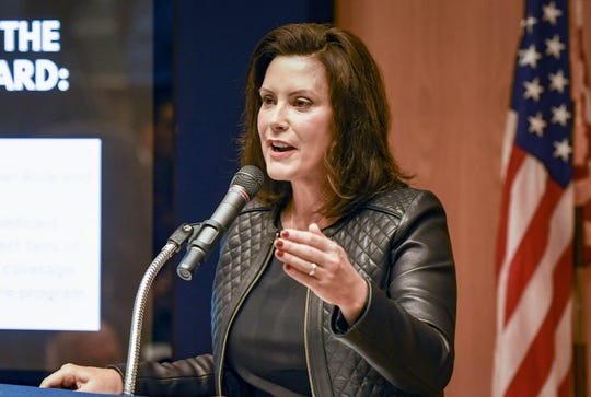Michigan Gov. Gretchen Whitmer speaks about the state budget Tuesday, Oct. 1, 2019, during a press conference at the State Library and Michigan History Center in Lansing, Michigan.  [AP Photo/Matthew Dae Smith/Lansing State Journal]