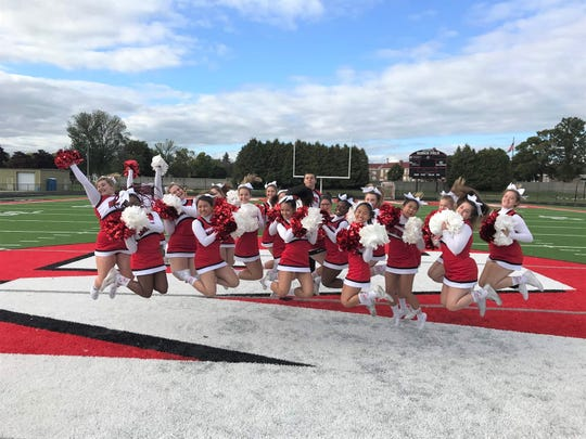 The Manitowoc Lincoln High School varsity cheer team jumps with excitement before a September football game. The community is invited to the Ships' homecoming game at 1 p.m. Oct. 5.