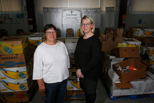 Jan Freis, left, and Pastor Leah Woehr-Grande, right, pose for a portrait on Monday, September 30, 2019, at Interfaith Food Pantry in Plover, Wis. Together, they run the pantry to help those in need in the Plover area.