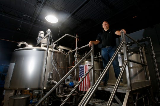 District 1 Brewing Company owner Chris Gethers poses for a portrait on Friday, September 27, 2019, at District 1 Brewing Company in Stevens Point, Wis. The brewery is expected to open in November. Tork Mason/USA TODAY NETWORK-Wisconsin