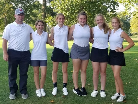 Shelby girls golf coach Nick Briggs with his state-bound Whippets: (left to right), Julia Gutchall, Gillian Stumbo, Maci Westmeister, Tressie Carroll and Nicole Jones