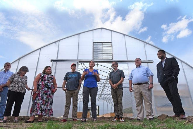 Amanda Stanfield, center, talks about the GrowFourth Urban Farm before a ribbon-cutting ceremony on Tuesday.