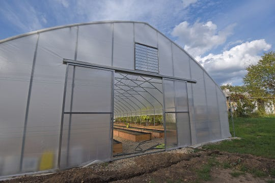 One of the two greenhouses at the GrowFourth Urban Farm near the corner of Fourth Street and Rowland Avenue.