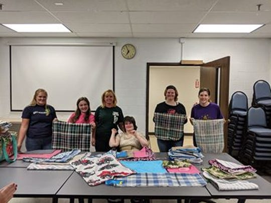 Cadette Girl Scouts of Troop 1275 have made clothing protectors for the residents of Raintree, as part of their Silver Award Project.