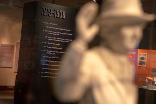 "October 1, 2019 - A historical timeline and a statue of former Memphis mayor ""Boss"" E.H. Crump are displayed inside the ""Making Memphis: 200 Years of Community"" exhibit at the Pink Palace Museum."