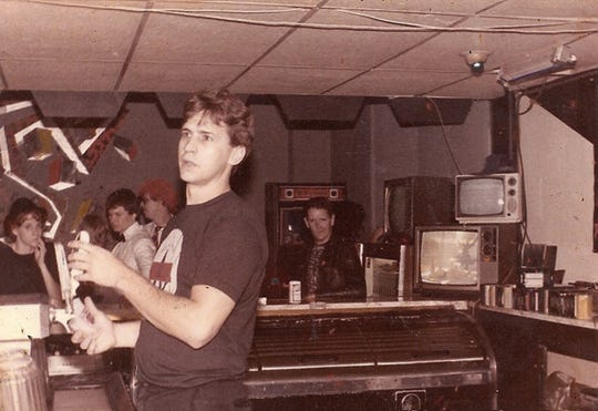 Steve McGehee tends bar at the Antenna Club in this undated photo.