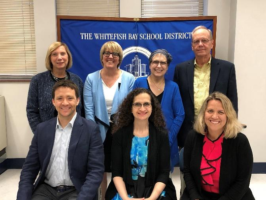 Kristin Yunker (third from left, back row) poses with fellow Whitefish Bay School Board members. Yunker died Sept. 24 of complications from breast cancer. Pictured are (from left, front row) board Treasurer W. Brett Christiansen, President Sandy Saltzstein, Vice President, Clerk Kristin Bencik-Boudreau, (back row) board members Pam Woodard, Anne Kearney, Yunker and Doug Armstrong.