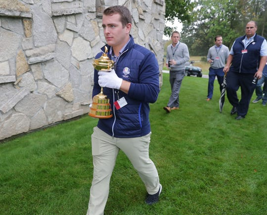 Brian Powers, operations coordinator for the PGA of America, carries the Ryder Cup trophy during the 2020 Ryder Cup Year-to-Go news conference at Whistling Straits golf course in Haven on Tuesday, Oct. 1, 2019. The Ryder Cup will take place Sept. 25 to 27 next year on the course owned by Kohler Co.