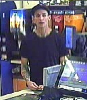 """On Sept. 10, police said this man entered a Speedway gas station in Greenfield and used a stolen debit card to make his purchases. On Oct. 1, police issued a call for help in identifying the man in the form of a """"missed connection"""" Craigslist post."""