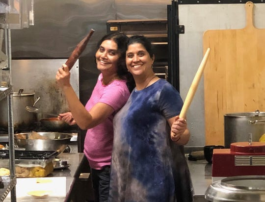 Holding rolling pins, Sonal Shah, left, and Lajwanti Waghray will be the cooks in the kitchen for a monthly series of Indian lunches at Amaranth Bakery & Cafe on the west side.