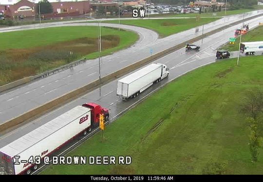 A squad car blocks the southbound lanes of I-43 at Brown Deer Road.