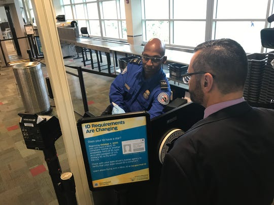 Transportation Security Administration Officer Nicholas Jackson checks the ID of Frank Pipia Jr. of the TSA Wisconsin field office at Dane County Regional Airport Tuesday. Federal identification requirements for domestic flights change on Oct. 1, 2020.