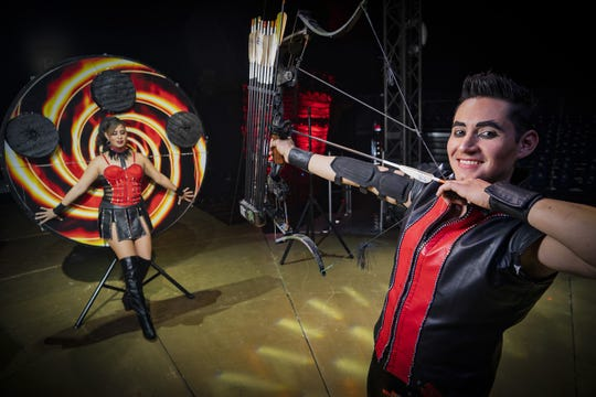 Hector Pazaran and Elizabeth Vizuet perform a crossbow act during Cirque Italia's Silver Unit show. The traveling production will stop in Greendale at the end of October.