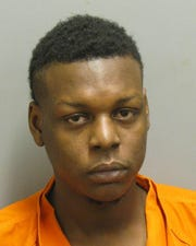 Latrell Johnson was charged with first-degree robbery.