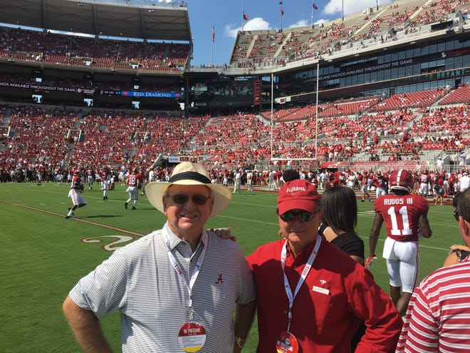 From left, Mickey Griffin and Barrie Harmon are on the sidelines before the Ole Miss-Alabama game.