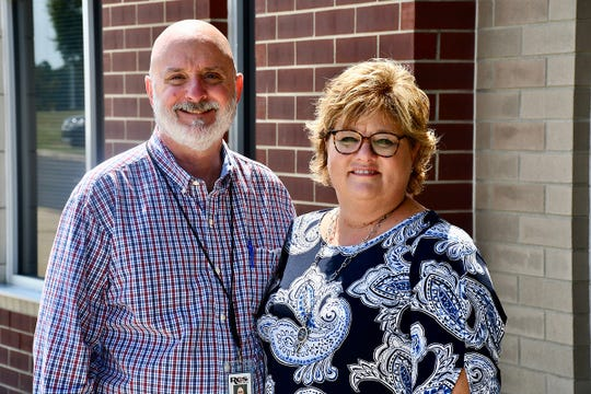 Trey Lee, left, assistant superintendent of engineering and construction for Rutherford County Schools, and his wife, Kim, pose for a photo at Stewarts Creek Middle School, where she sife works. Lee completed a 30-year journey to earn his Bachelor of Science in Construction Management in August from MTSU thanks to a flexible adult degree completion program.