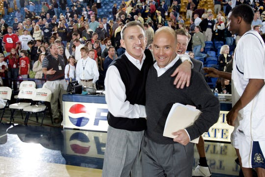 Belmont basketball coaches Rick Byrd and Casey Alexander embrace after Belmont's 94-67 victory at East Tennessee State in the 2007 Atlantic Sun Championship.
