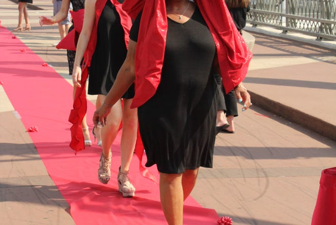 Lynn Moore, who received a lung transplant three years ago, is beaming down the red carpet.