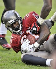 Tampa Bay Buccaneers cornerback Phillip Buchanon (31) clutches the ball after intercepting a pass from New Orleans Saints quarterback Drew Brees late in the fourth quarter of an NFL football game on Sunday, Nov. 30, 2008, in Tampa.