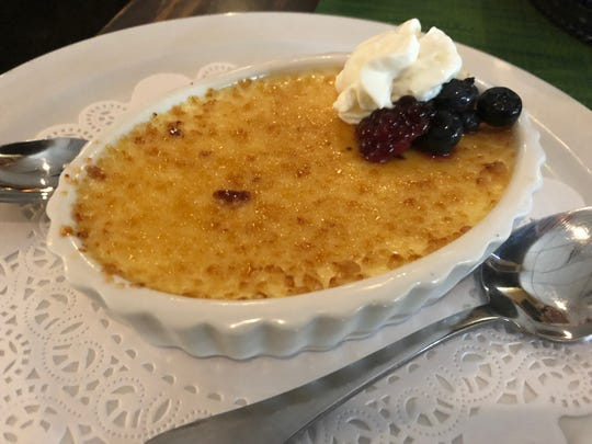 The Crooked Shillelagh's creme brulee is deliciously creamy and includes berries drenched in whiskey.