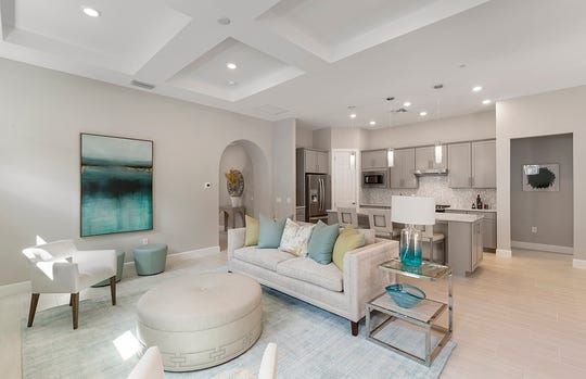 One of 12 home designs offered by Pulte Homes at Greyhawk at Golf Club of the Everglades, the professionally designed Summerwood home shows potential homebuyers the possibilities for a Clive Daniel-decorated home.