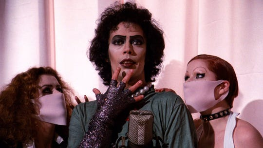 """Tim Curry as Dr. Frank-N-Furter in a scene from """"The Rocky Horror Picture Show."""""""