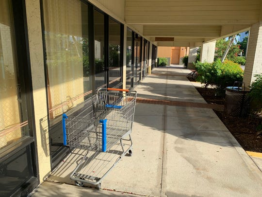 An empty shopping cart is seen abandoned at the Courthouse Shadows Shopping Center on Sept. 30, 2019.