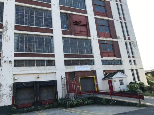 The former Ethan Allen distribution center in Passaic is being eyed by a developer interested in converting it as a mixed-use residential and retail project.