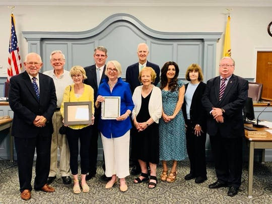 Members of the Wyckoff Historical Society are congratulated by Wyckoff Committee members on winning the Bergen County Historical Society Oratam Award for their efforts restoring the Union Cemetery.