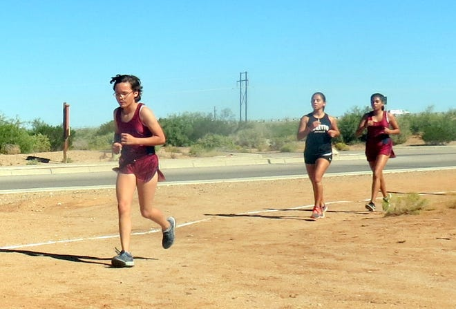 Lady 'Cat Elianna Esnayder is in front for the Lady 'Cats while teammate Amanda Santistevan is gaining at far right.